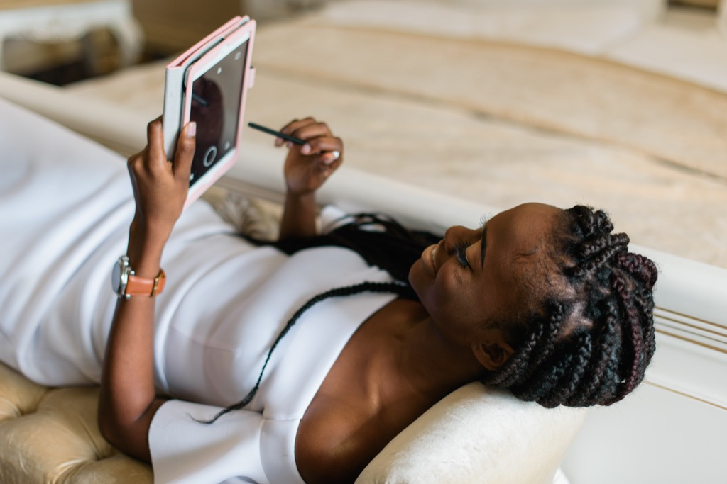 woman using tablet on sofa long-distance relationships