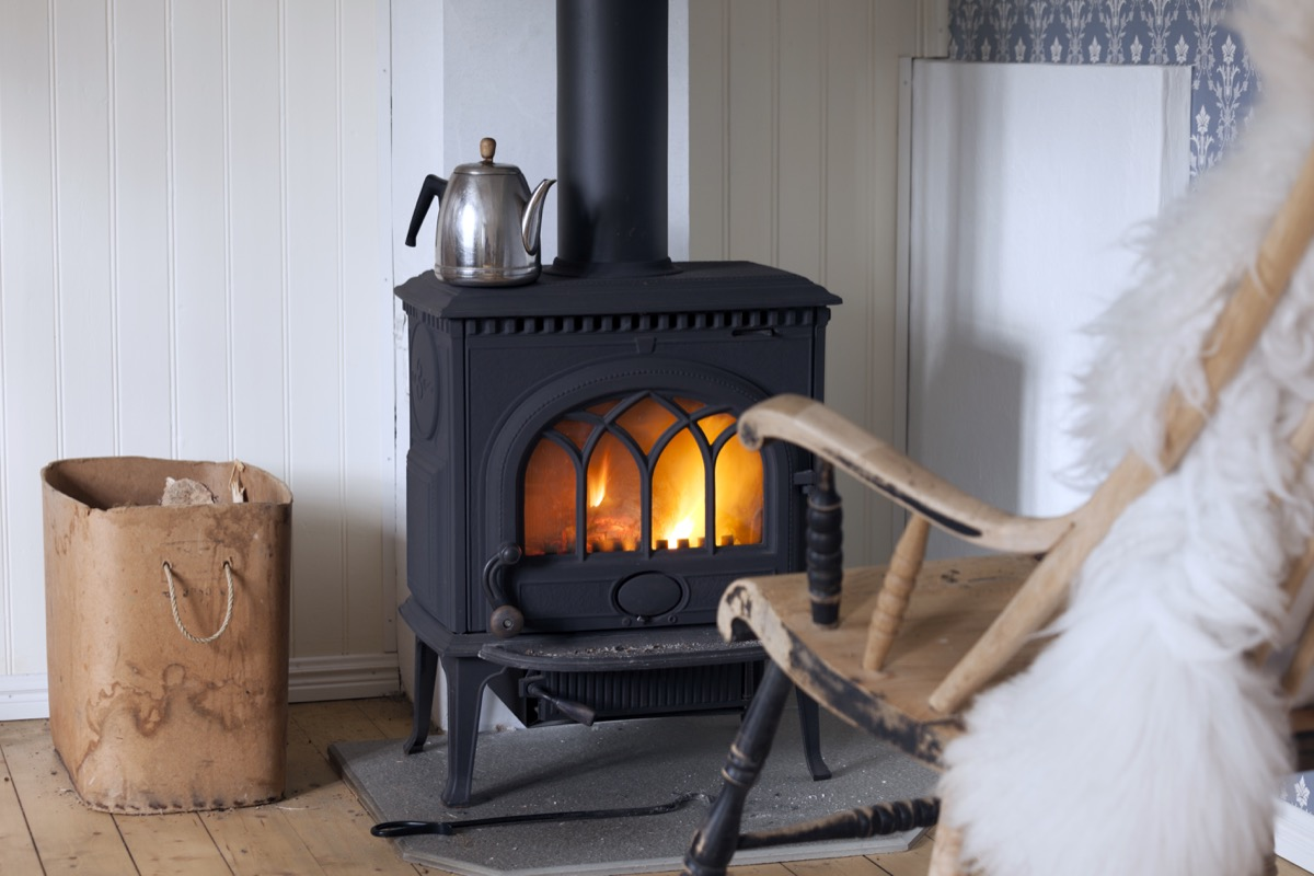 A wood stove next to a rocking chair home hazards