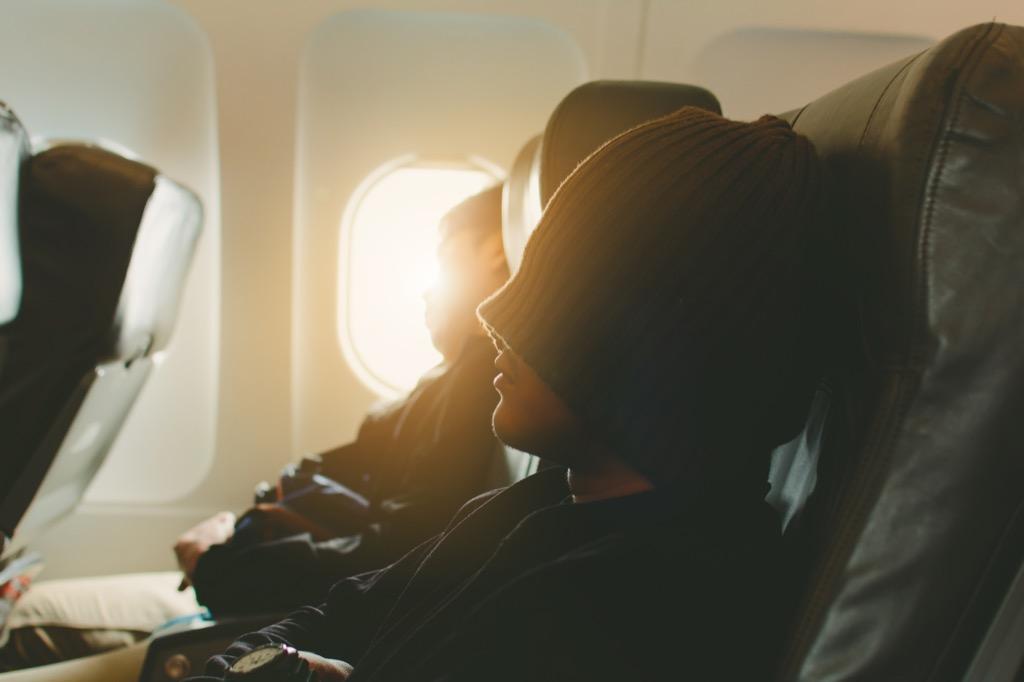 People sleeping on an airplane.