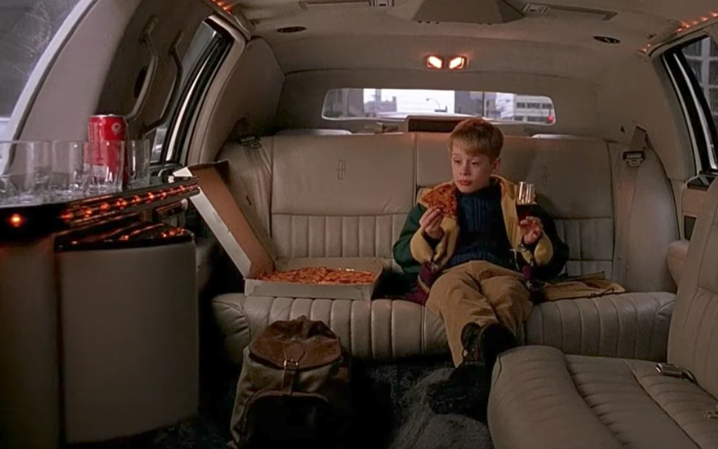 Kevin McAllister in the back of a limo, from Home Alone 2.