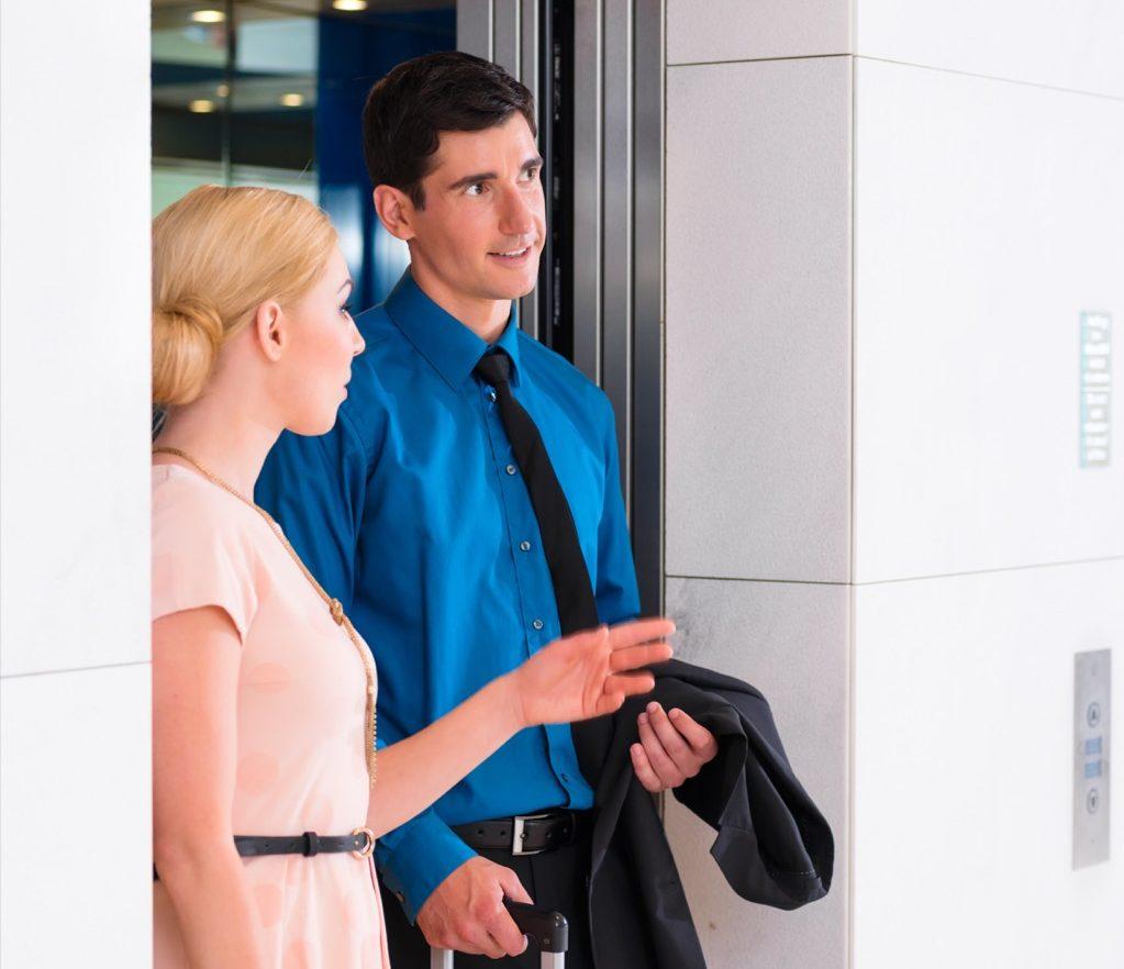 elevator etiquette putting on jacket
