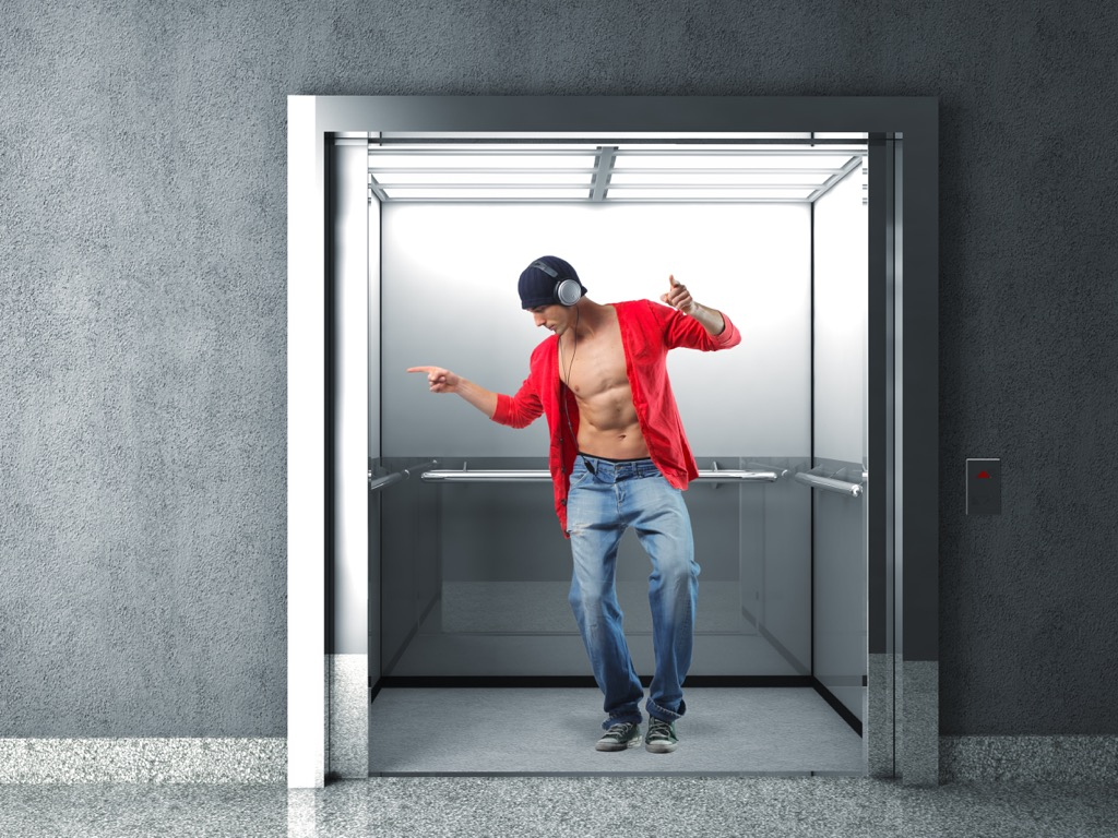 elevator etiquette man on phone