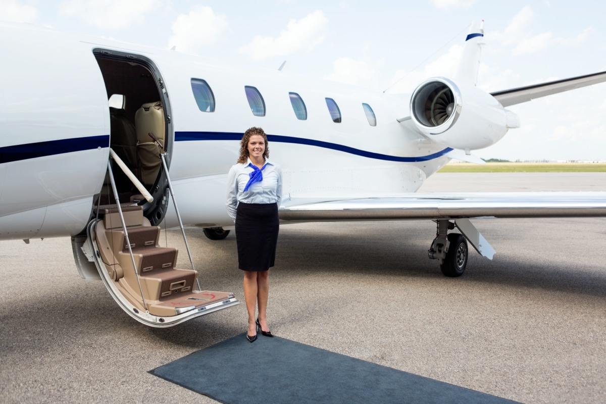 flight attendant waiting for the passengers private jet