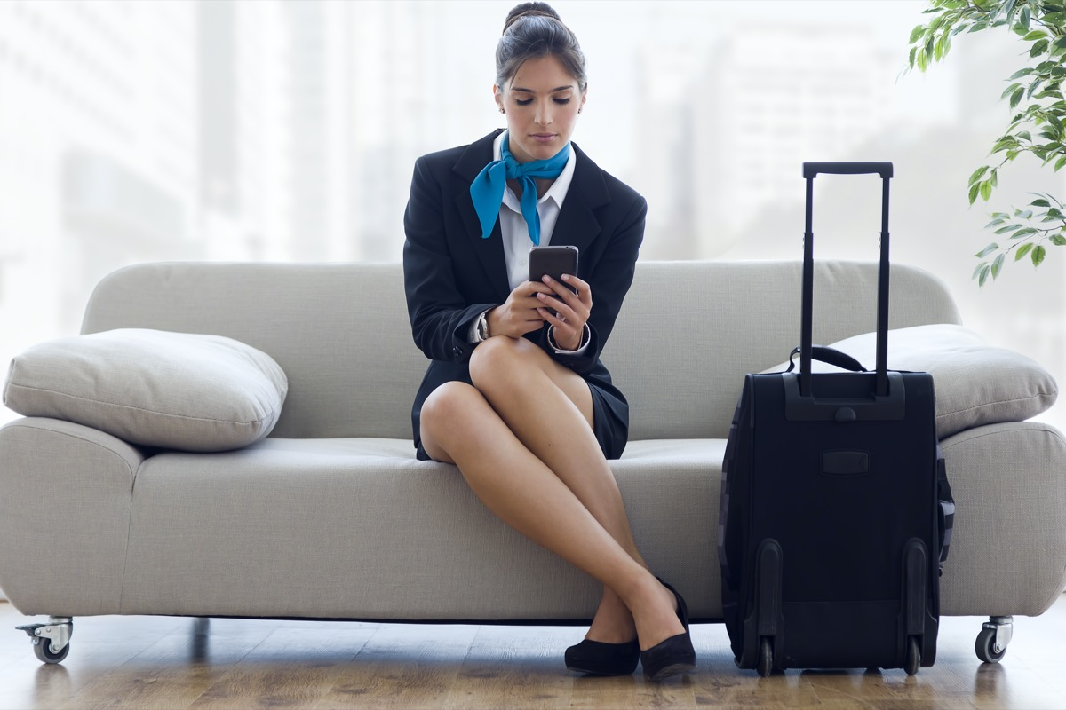 flight attendant looking exhausted