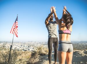 Couple celebrates on top of hill, representing their resolutions