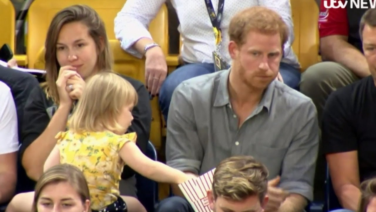 toddler stealing popcorn from prince harry