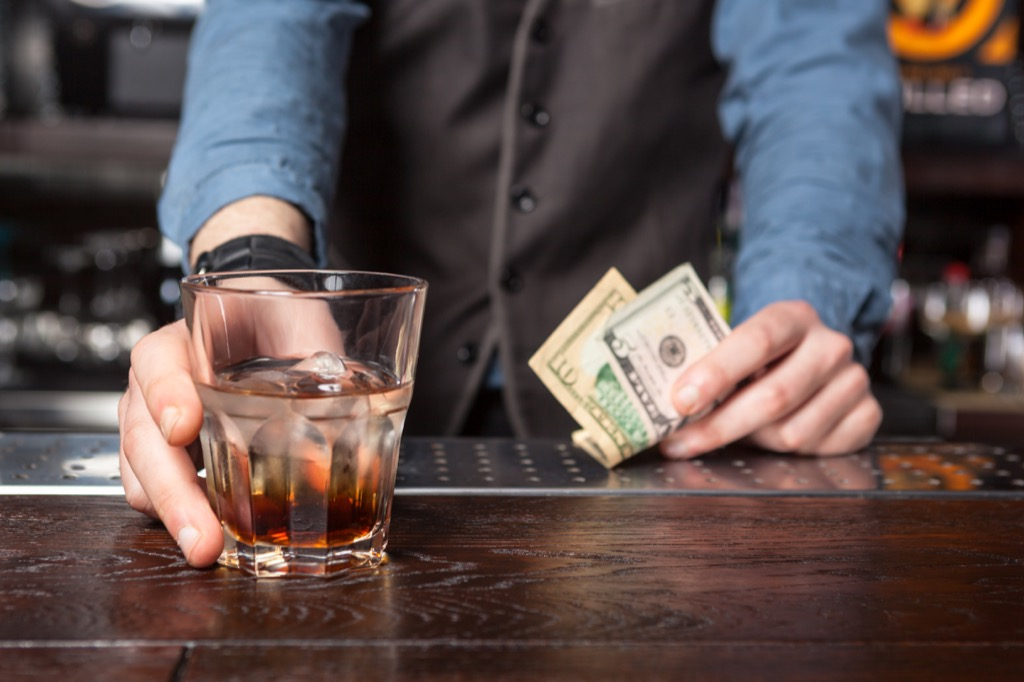 bartender pushing drink across bar, facts about the lottery