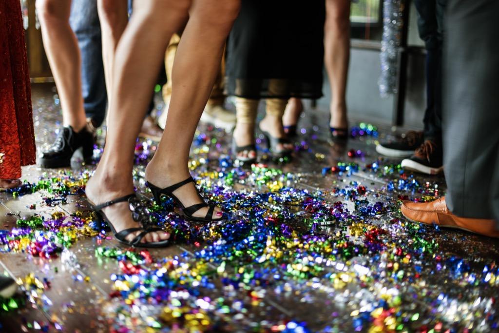 woman in heels standing in confetti, '60s slang