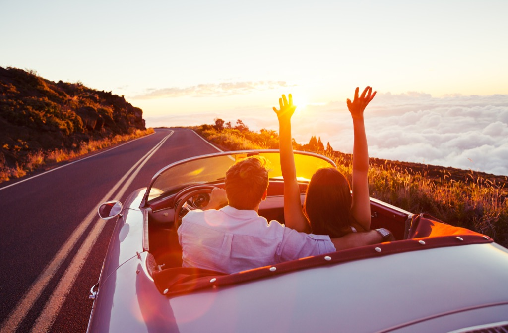 couple in car driving on highway advice you should ignore over 40