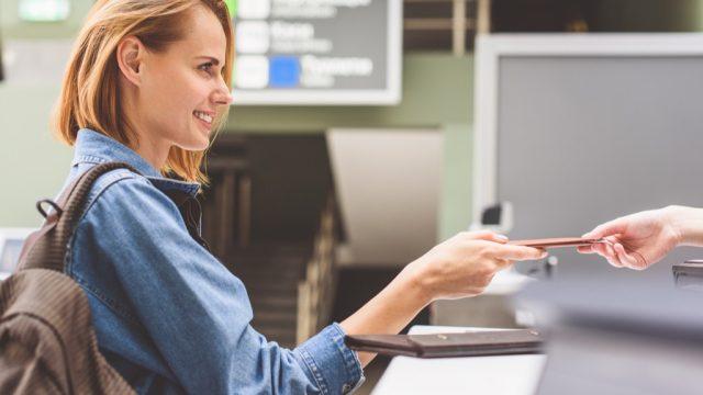 woman at airport getting cheap airfare