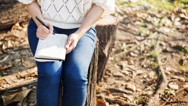 woman writing in journal health tweaks over 40