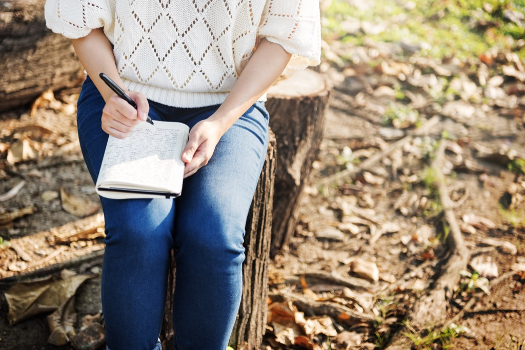 woman writing in journal weight loss
