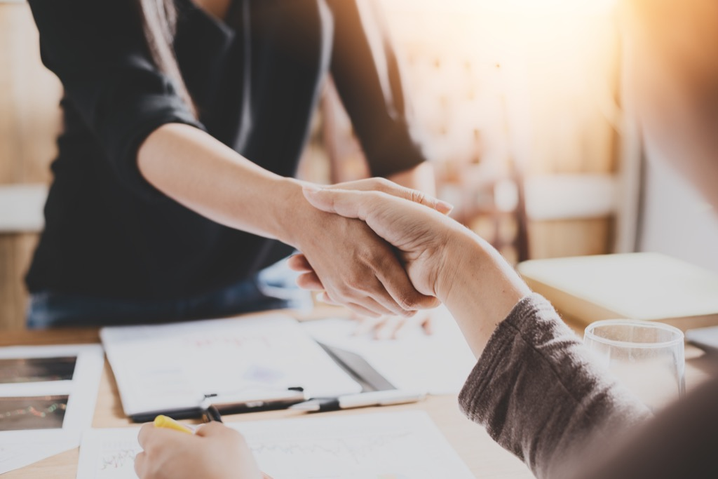 Shaking hands mortgage payment