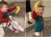 boy cheerfully holds up banana toddler banana christmas gift