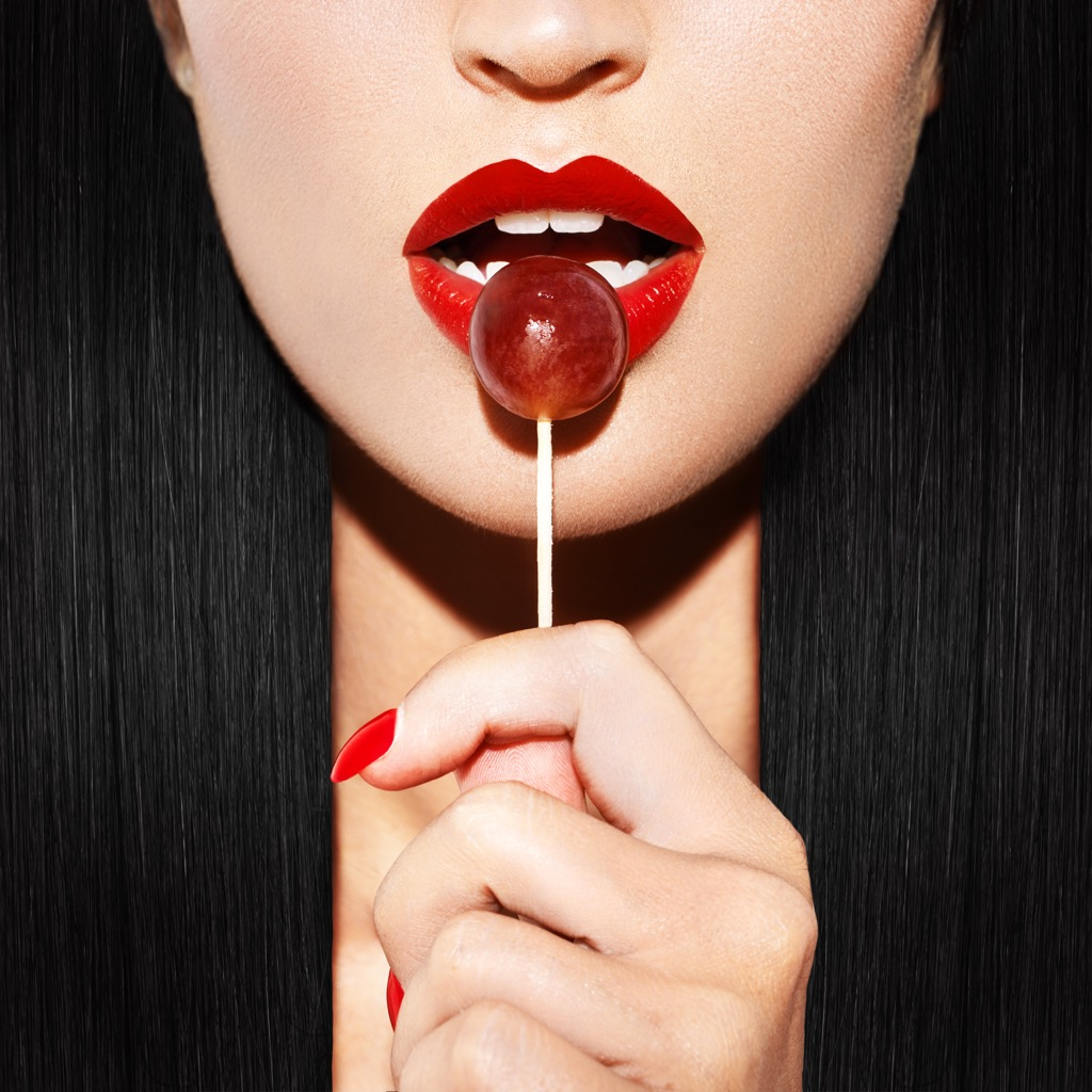 Woman licking lollipop awesome facts
