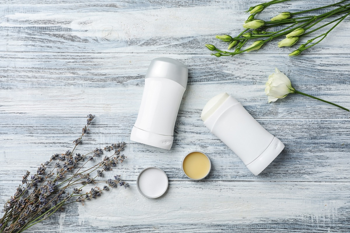 deodorant on table with roses