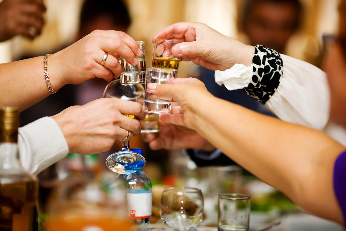 Friends taking shots during the Christmas holiday season