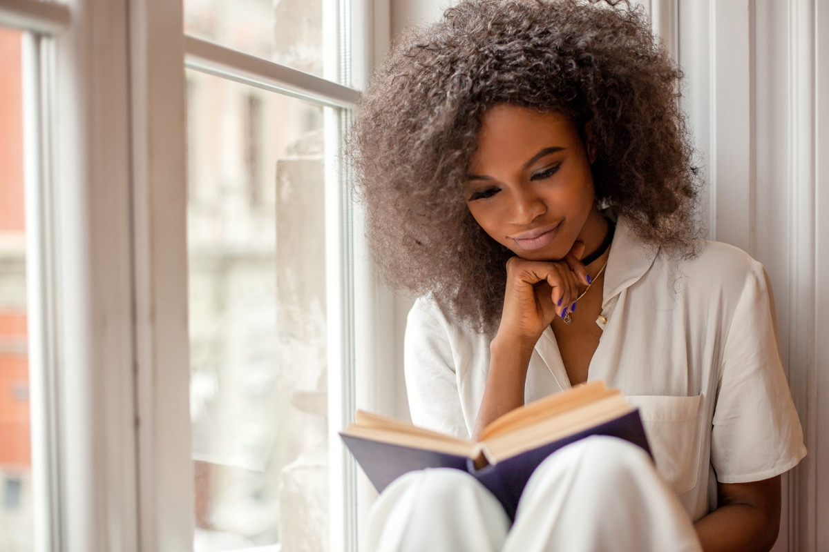 Girl reading book happily