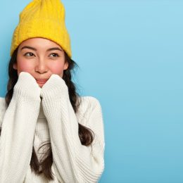 Happy cozy girl in hat and turtleneck