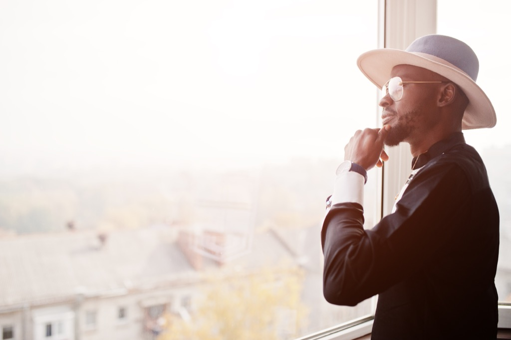 Man Looking Out Window Energy After 40