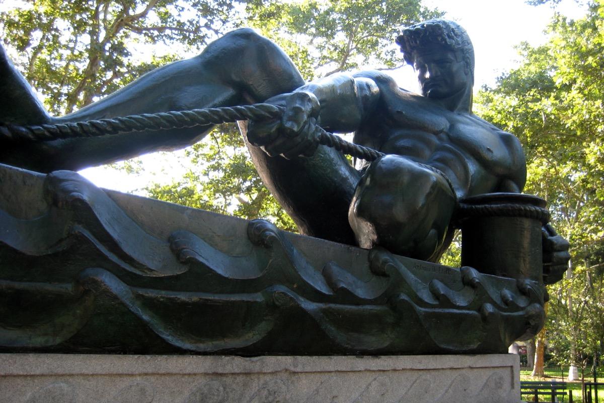man pulling rope statue brooklyn