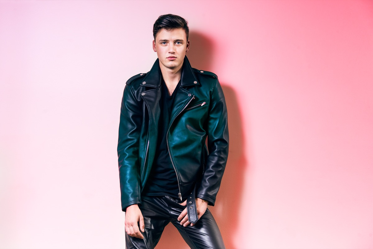 man wearing leather pants and a leather biking jacket