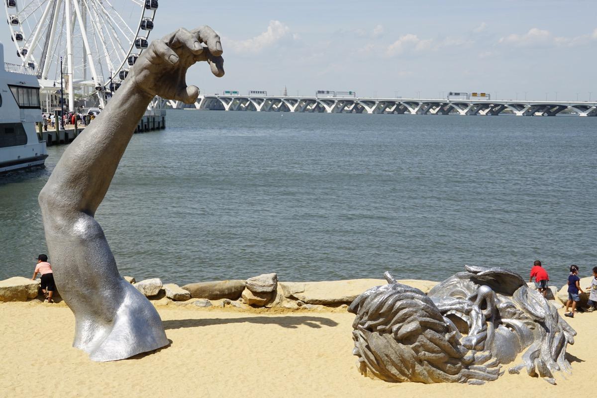 national harbor awakening statue