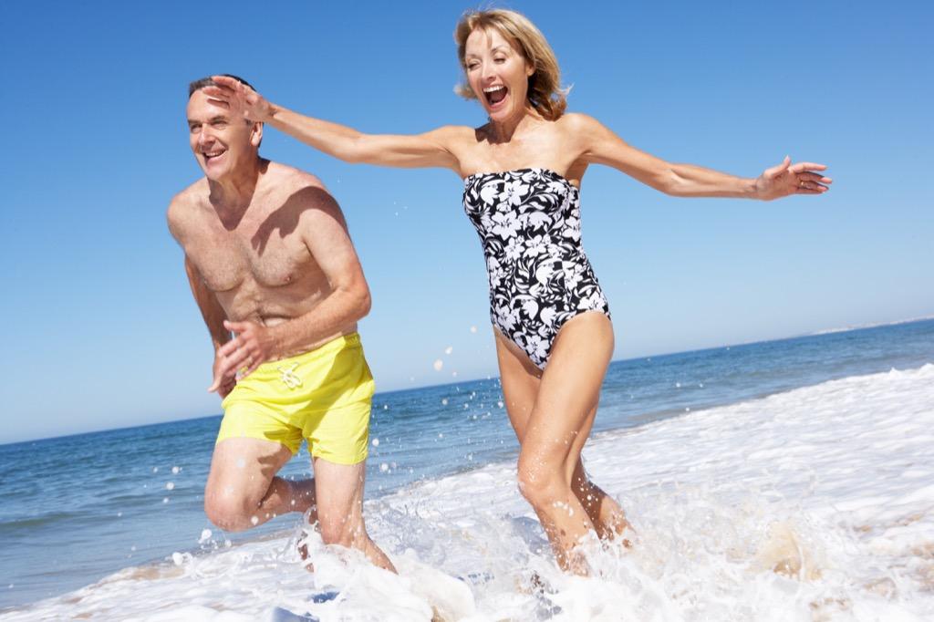older couple splashing on the beach, school nurse secrets