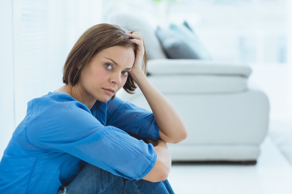 woman looking upset with her hands on her knees, things divorced people know