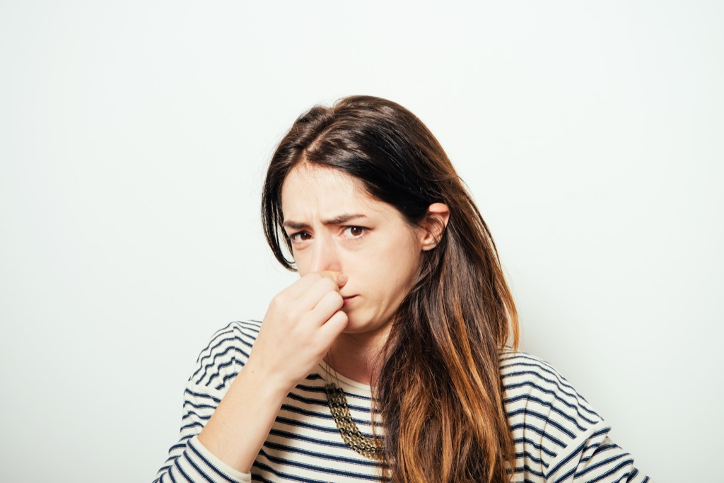 Woman Plugging Nose Over 40