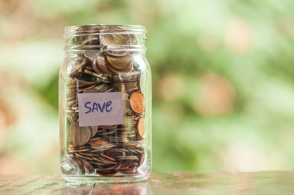 """jar filled with change labeled """"save"""""""