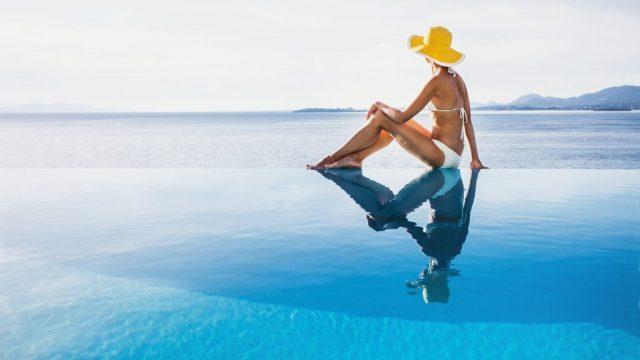 woman infinity pool vacation