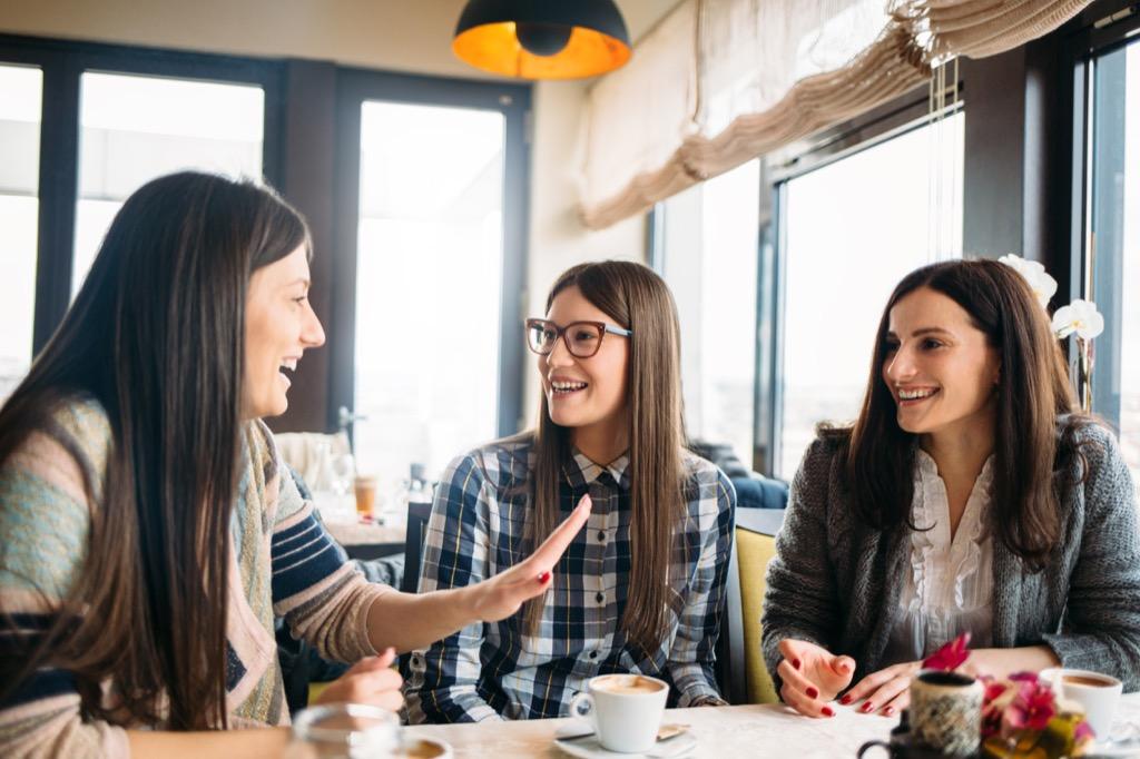 three girlfriends talking