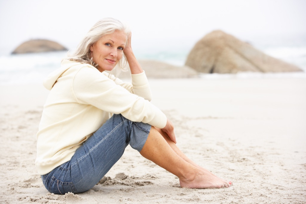 older woman on beach dating over 50