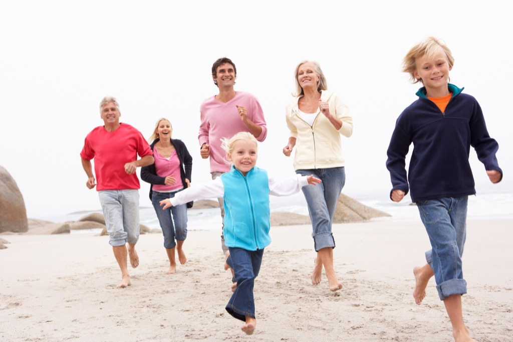 huge family running on beach together, how to make friends after 40