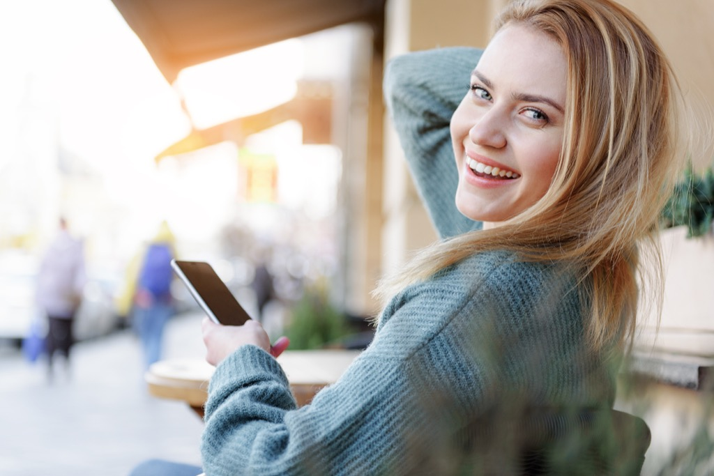 woman wearing a smartphone