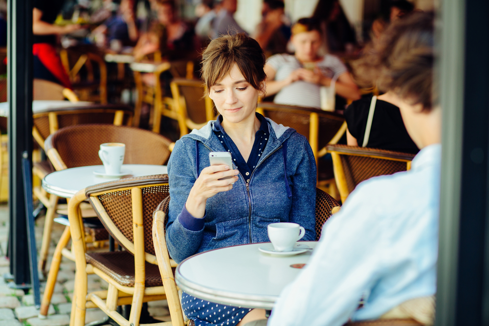 woman texting on date