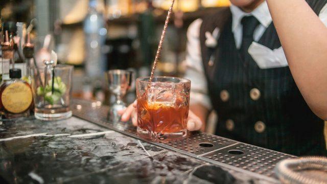 bartender making craft cocktail