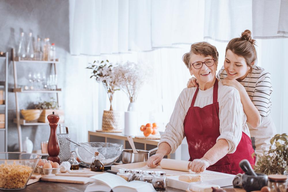 woman helps grandma cook