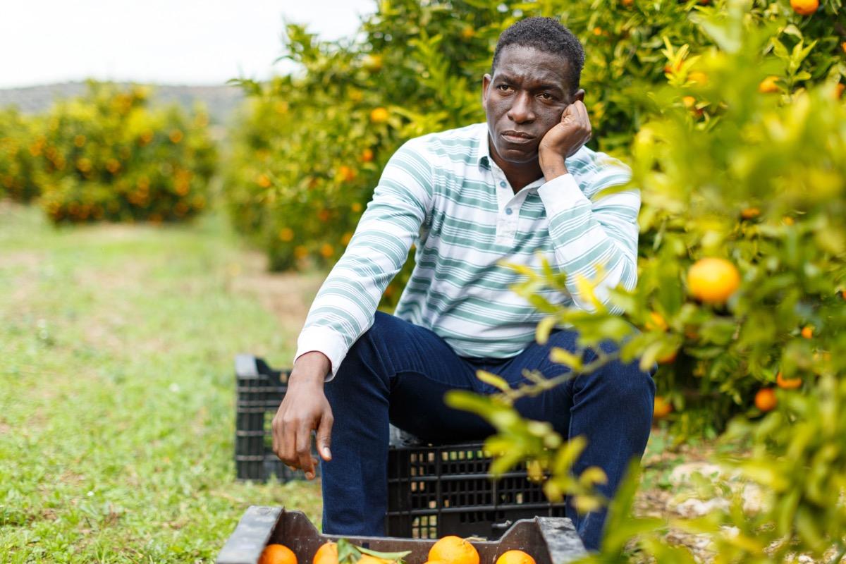 upset man sitting outdoors