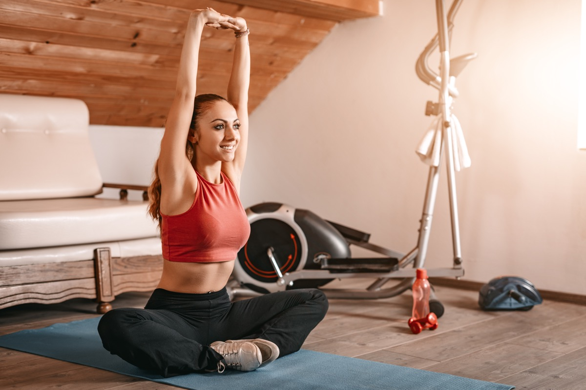 Woman stretching doing at home exercises
