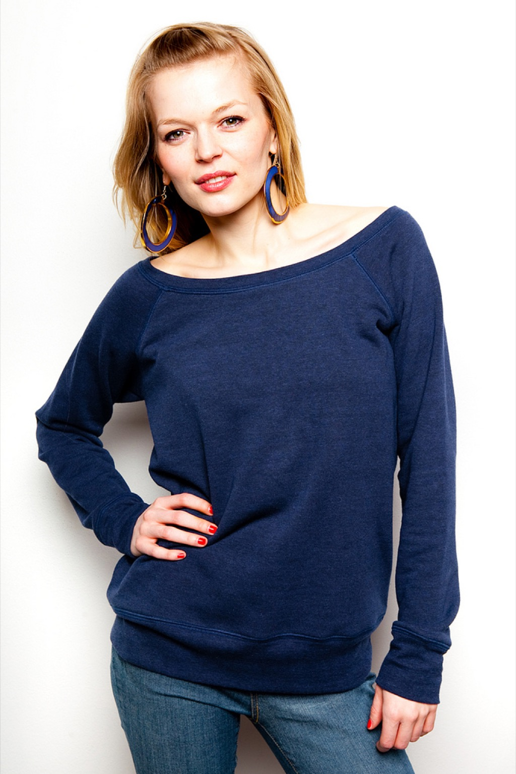 woman wearing a blue sweater - how to dress over 50