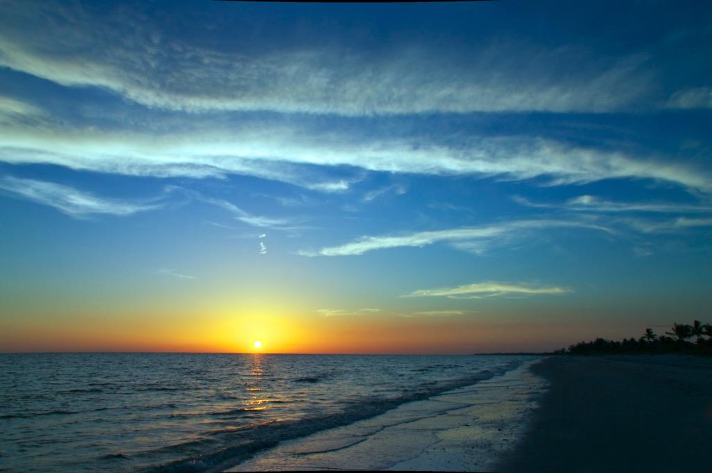 sunset on a beach, date night ideas