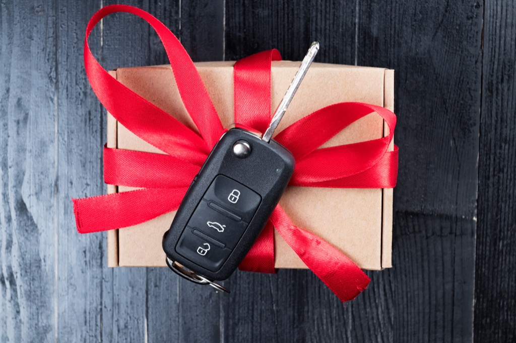 Car key wrapped in a bow as a gift, signs your husband is cheating