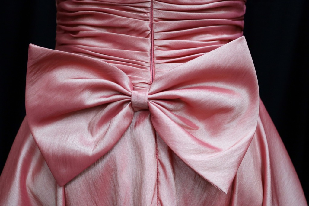 big pink bow on dress - how to dress over 50