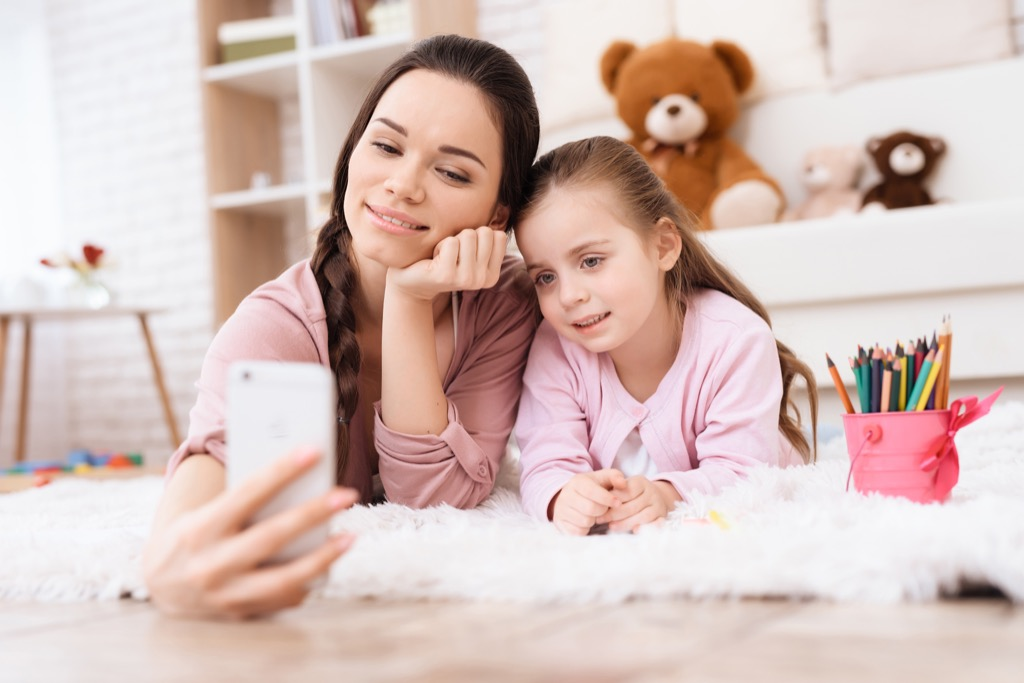 Mother and daughter on Smartphone