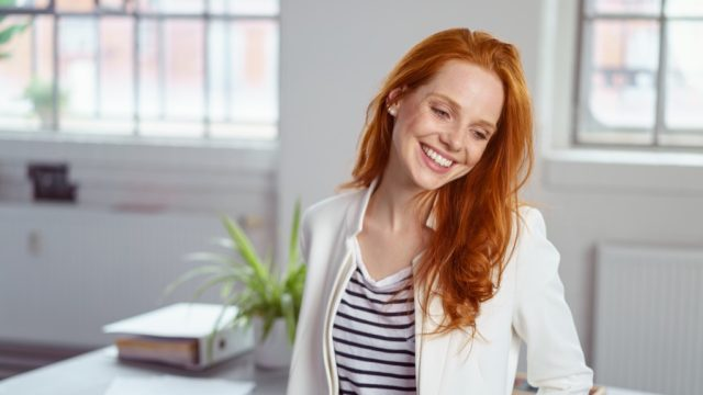 Woman with red hair, skin cancer facts