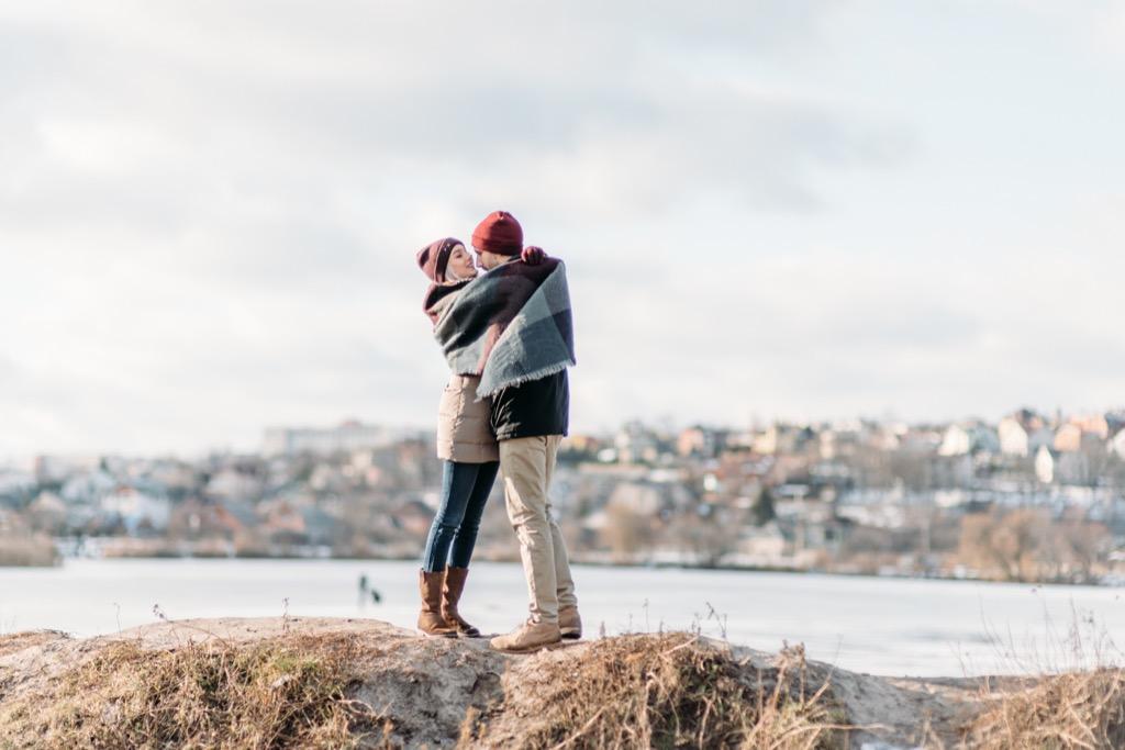 couple embracing hugging on some rocks
