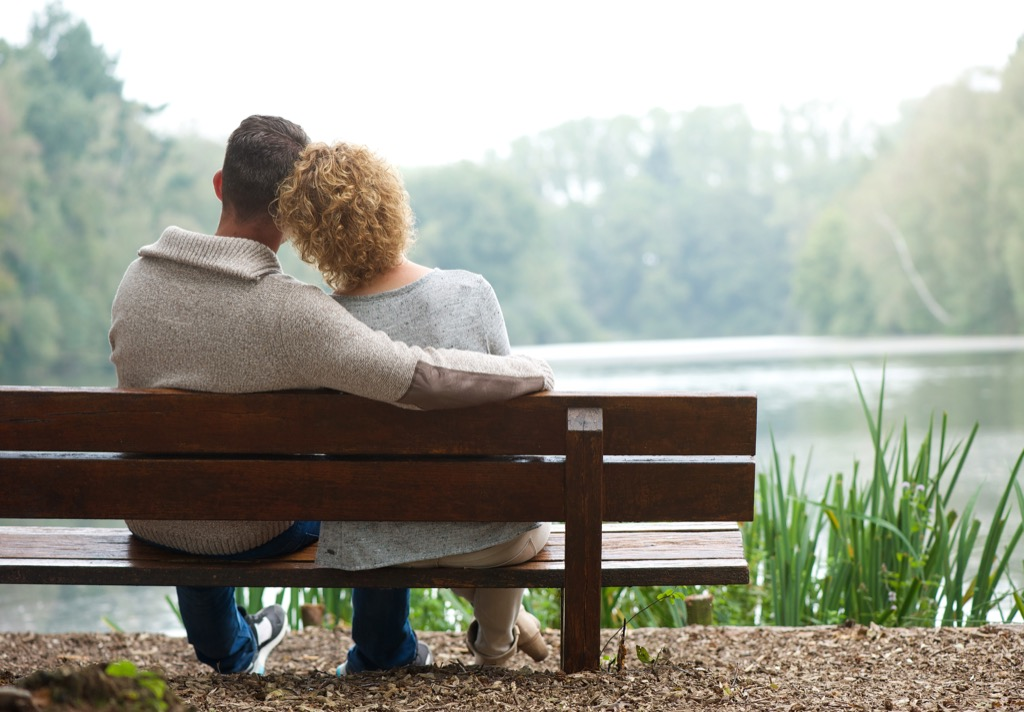 couple on a bench by a lake