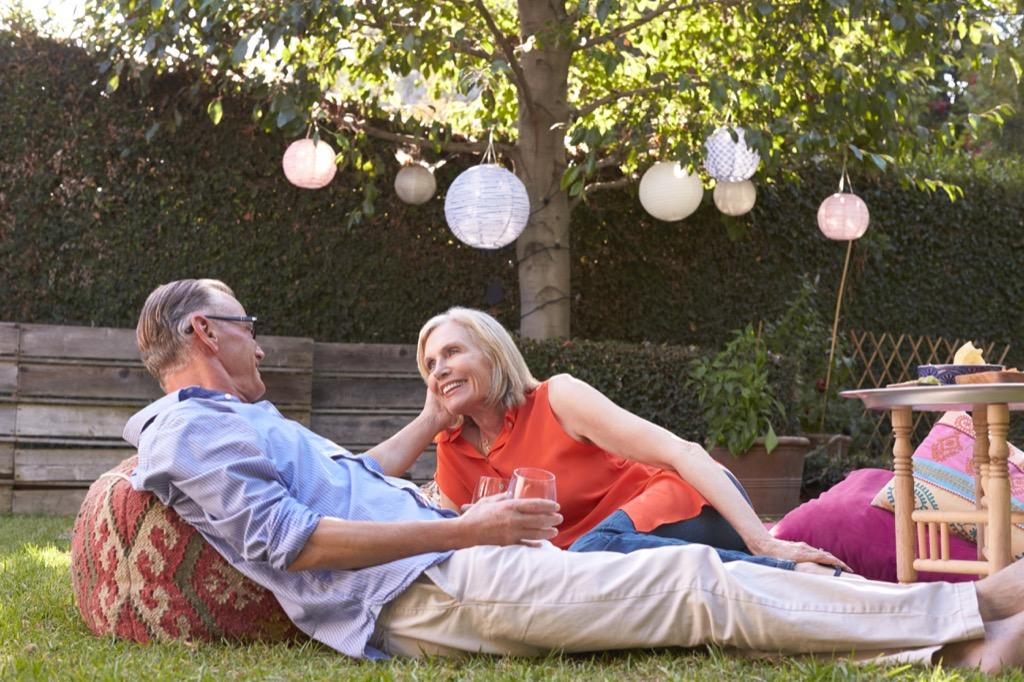 couple having picnic outside party